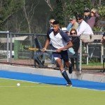 Blake Govender of Oakhills 2nd Team Boys with coach Brendan Keevey encouraging from the sidelines (Copy)